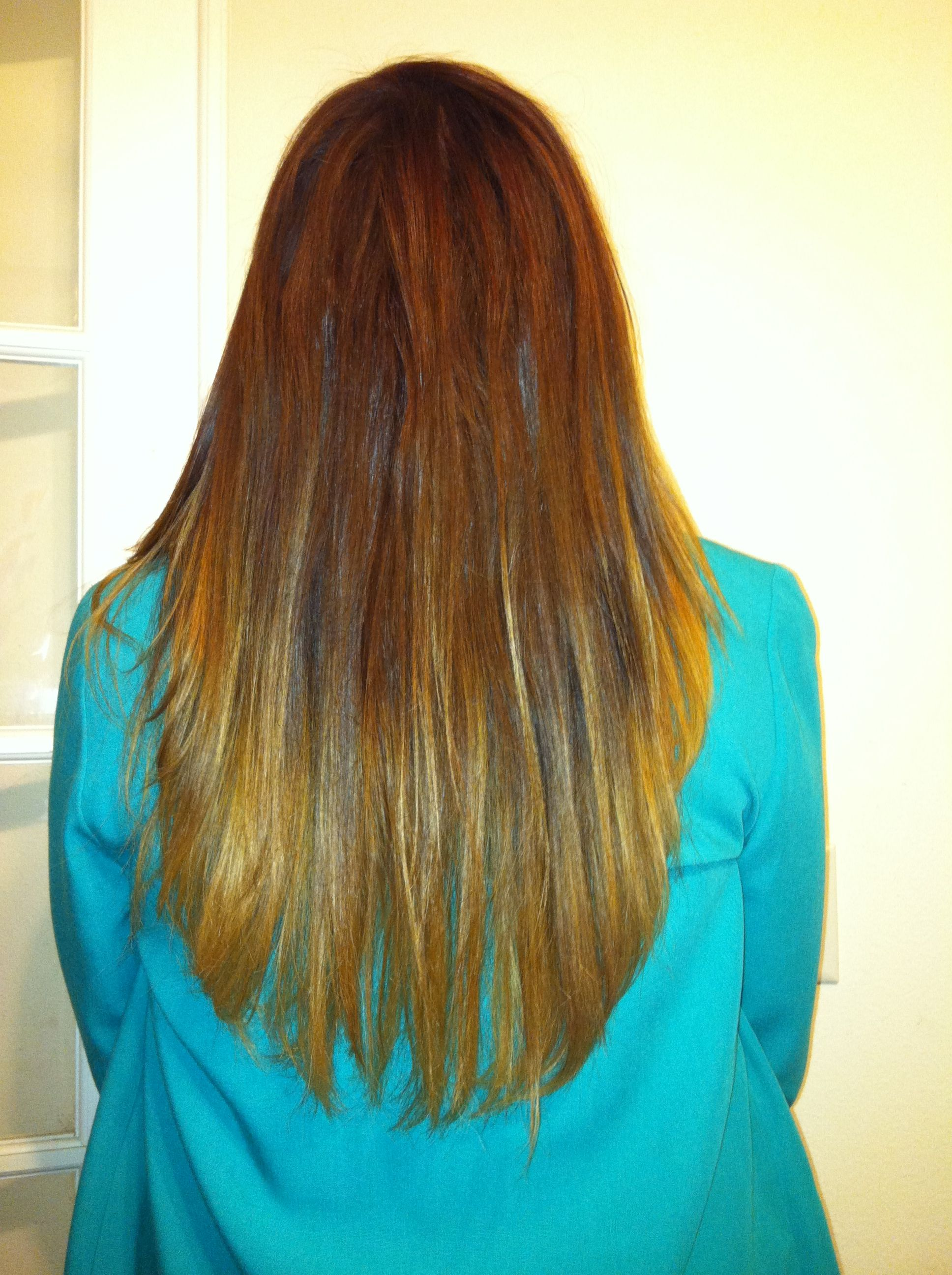 Red to blonde ombré done by Kelli ballou