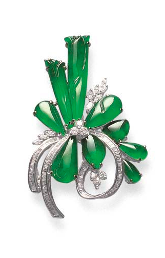 A JADEITE AND DIAMOND PENDANT/BROOCH Designed as a bouquet of jadeite flowers, buds and leaves, of highly translucent bright emerald green material, with circular-cut diamond trefoil and marquise-cut diamond accent, to the baguette-cut diamond scrolls, mounted in 18k white gold