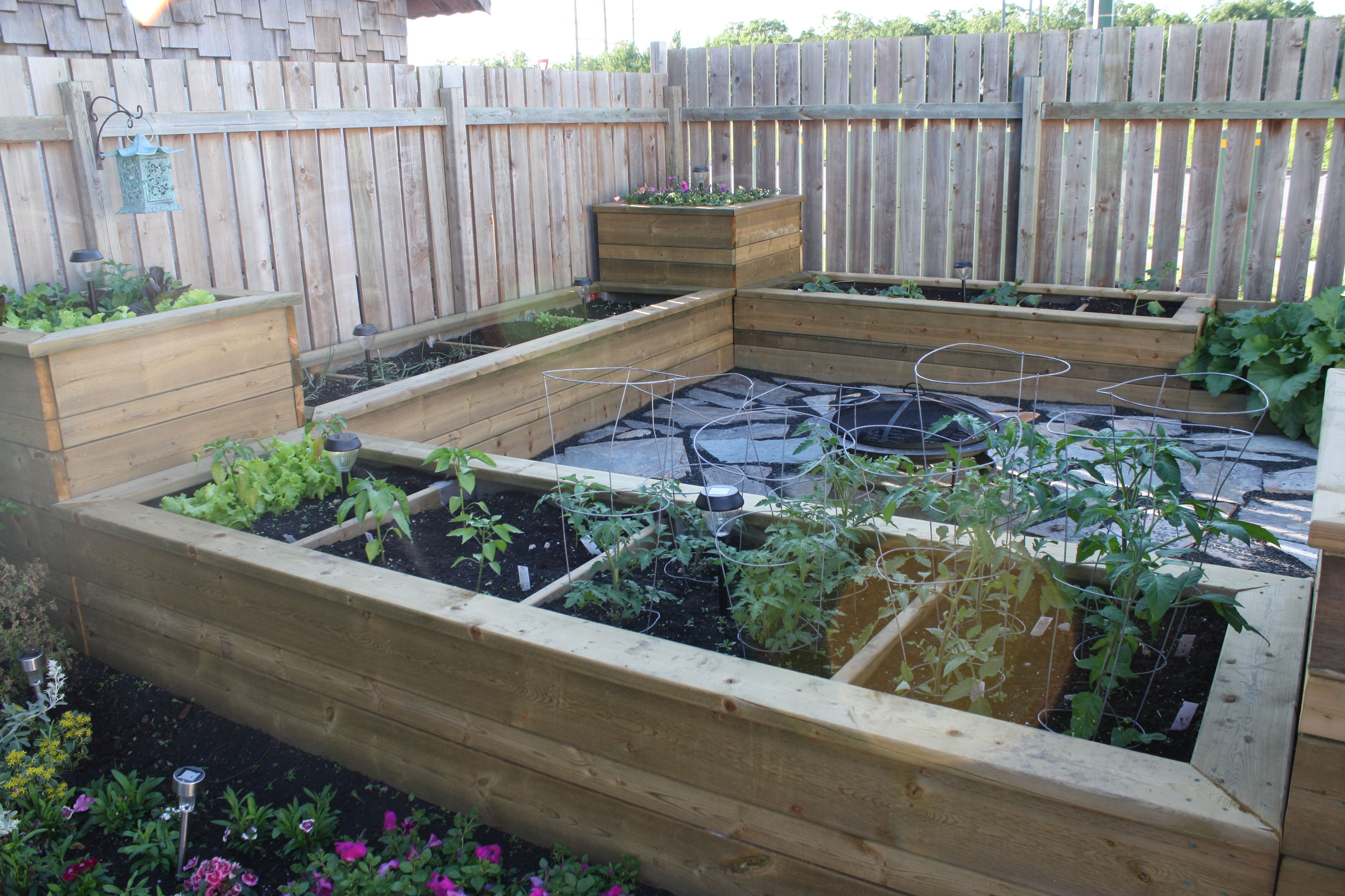 Raised garden beds in our backyard with Manitoba Flagstone ... on Raised Garden Patio Ideas id=20147