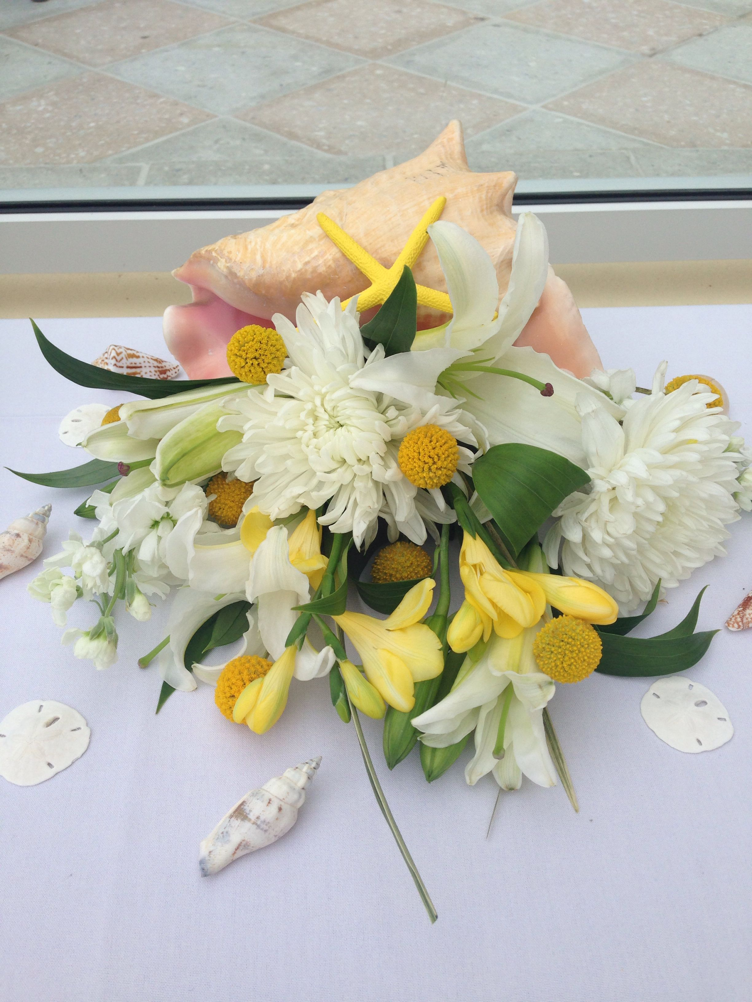 Conch Shell Flower Arrangements For Yellow And Grey Beach Wedding