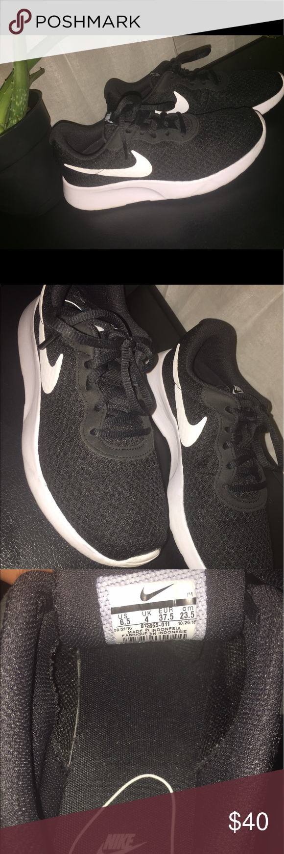 Nike sneaker Black and white Nike Women's Tanjun athletic sneaker. Great condition. Size 6.5. Super comfortable. Nike Shoes Athletic Shoes