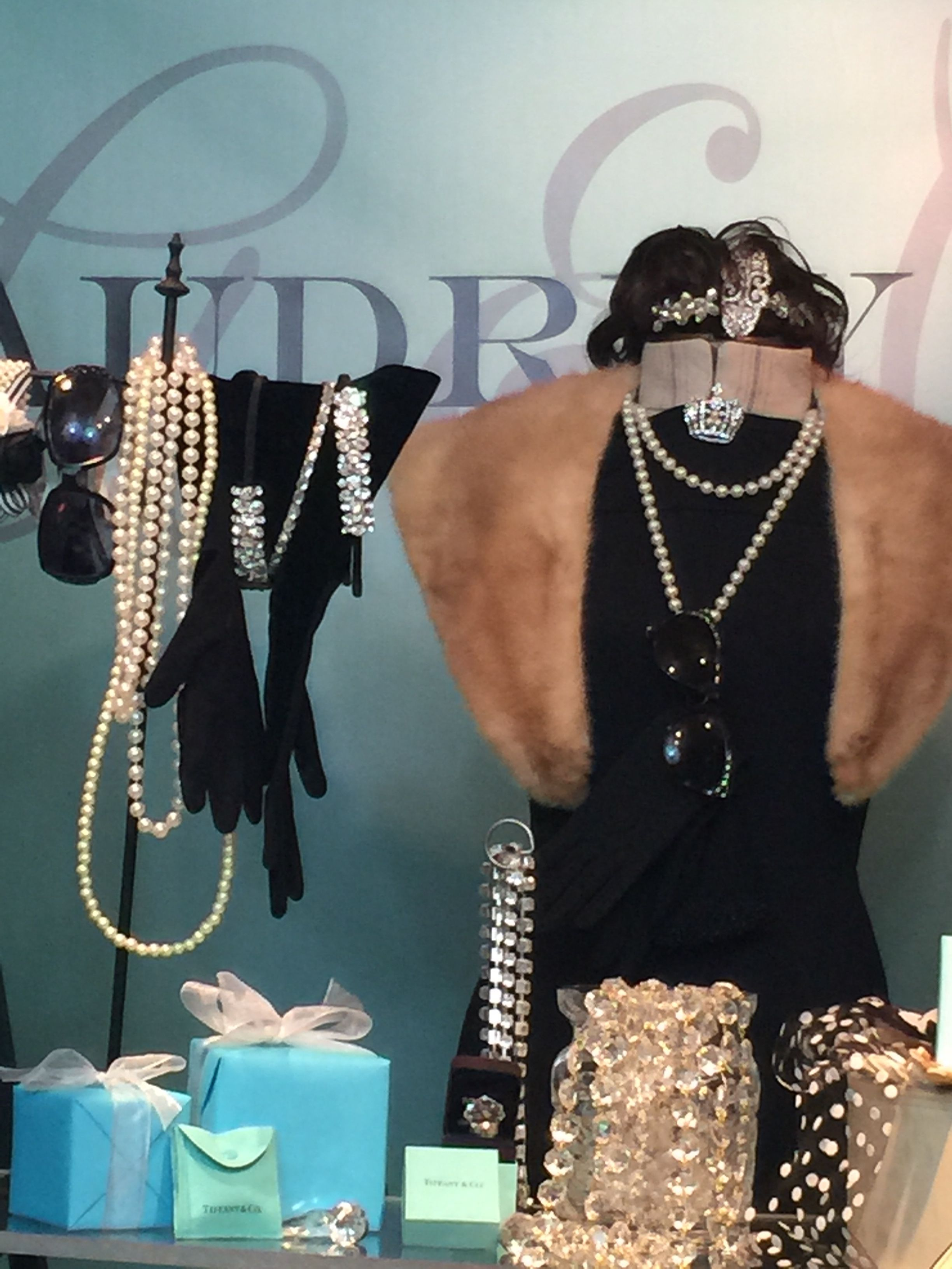 Black dress, pearls, tiaras, sunglasses, a lot of turquoise, crystals and throw in a fur or a cat and you have your movie set.