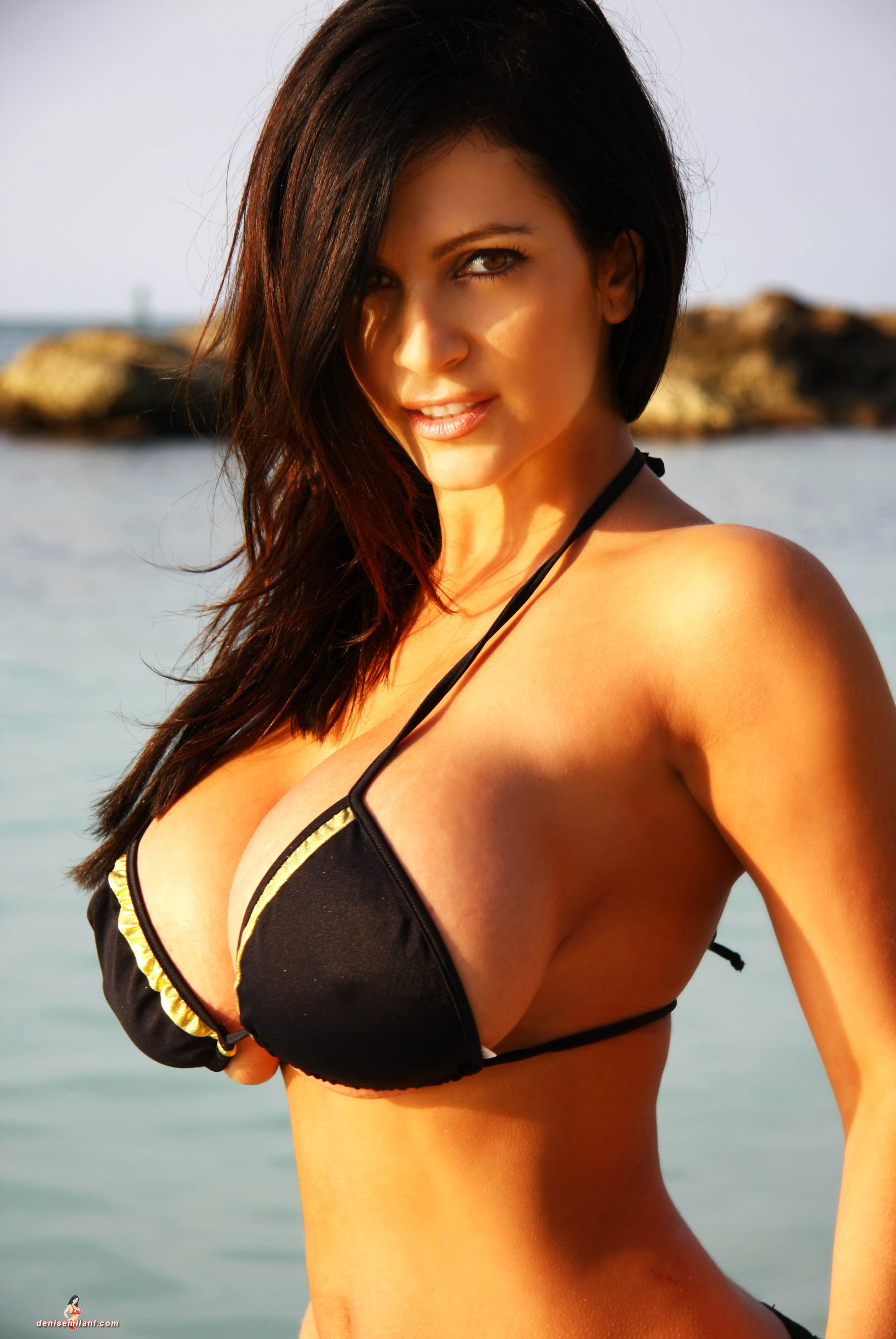 My all time favorite Denise Milani pic. Her perfect tits squeezed into a  way to small bikini top and shot from the side close-up is just amazingly  sexy!
