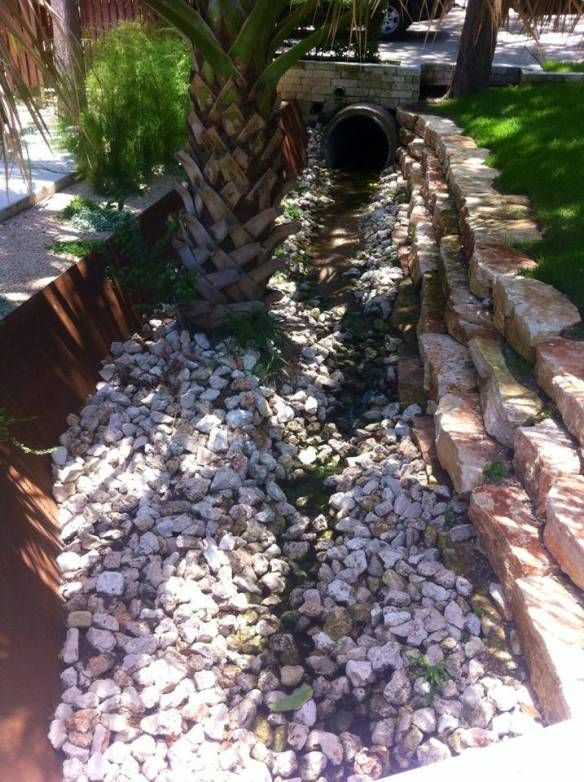 Removing The Rocks From A Residential Drainage Ditch Drainage Ditch Drainage Outdoor