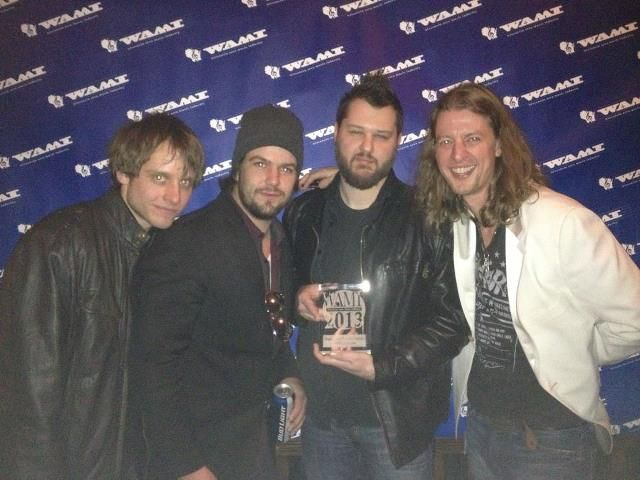 The Red Light Saints band received a People's Choice Award at the Wisconsin Area Music Award show in Milwaukee, Wisconsin on April 14, 2013.  Keywords: Red Light Saints WAMI People's Choice Award, Sonic M.D. Daniel Collins Green Bay Wisconsin