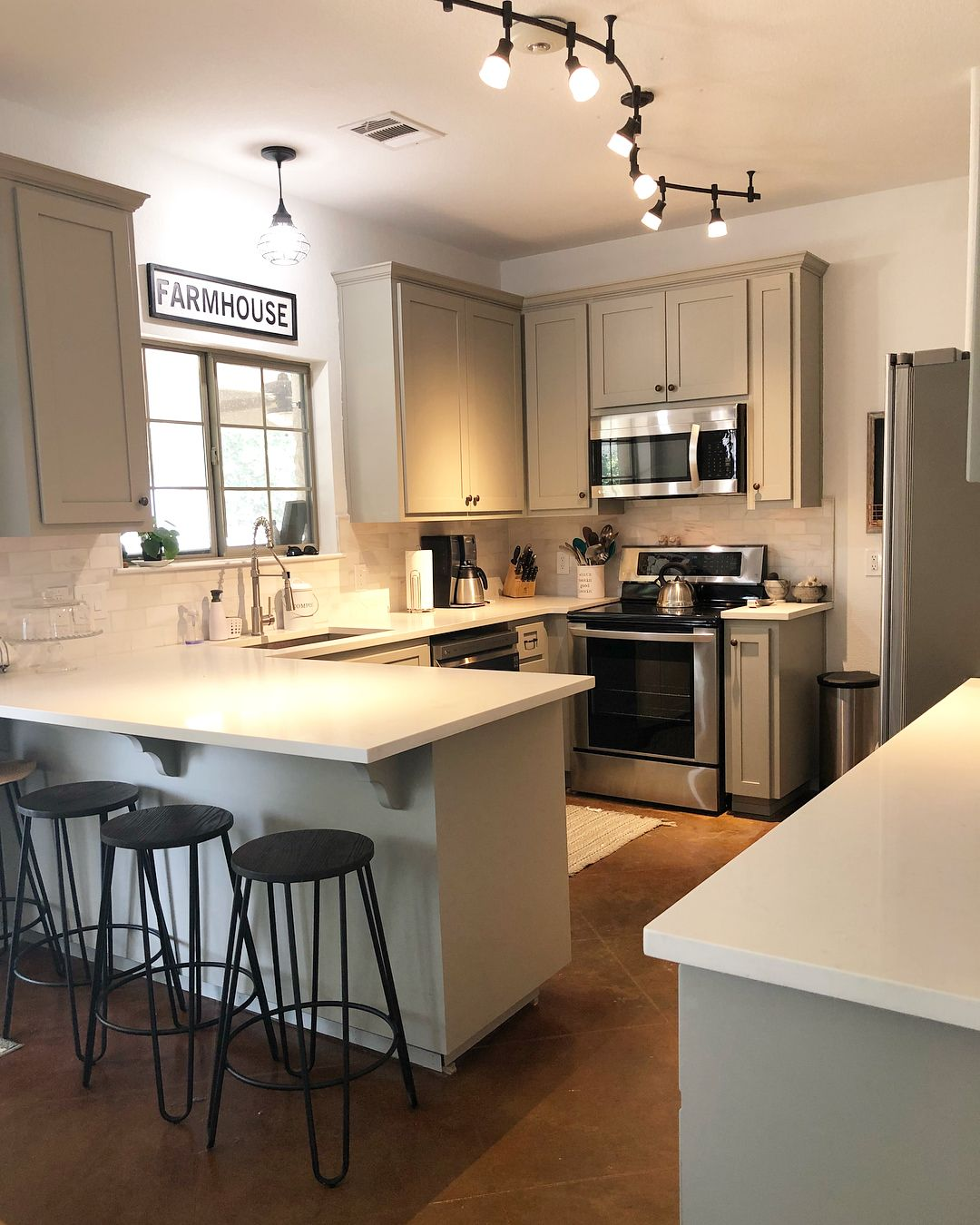 SW Dorian gray on these cabinets and new Carrara quartz for the countertops! The backsplash is ...