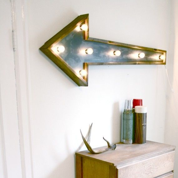 Awesome Arrow Light Fixture from Against the Woodgrain.  It would make a cool sign to direct people to the loo.