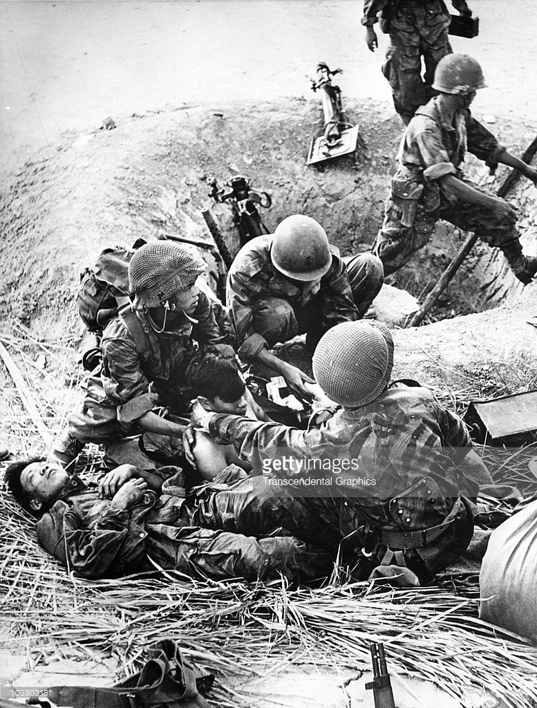 South Korean Soldiers Attending To A Fellow Soldier Wounded While In Foxhole 1952