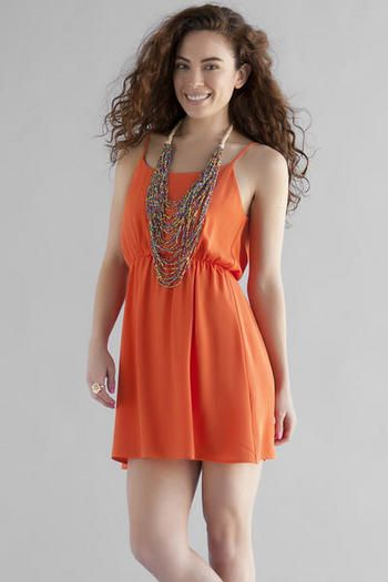 What s spring without a bright colored dress  A statement necklace ... 25f852575