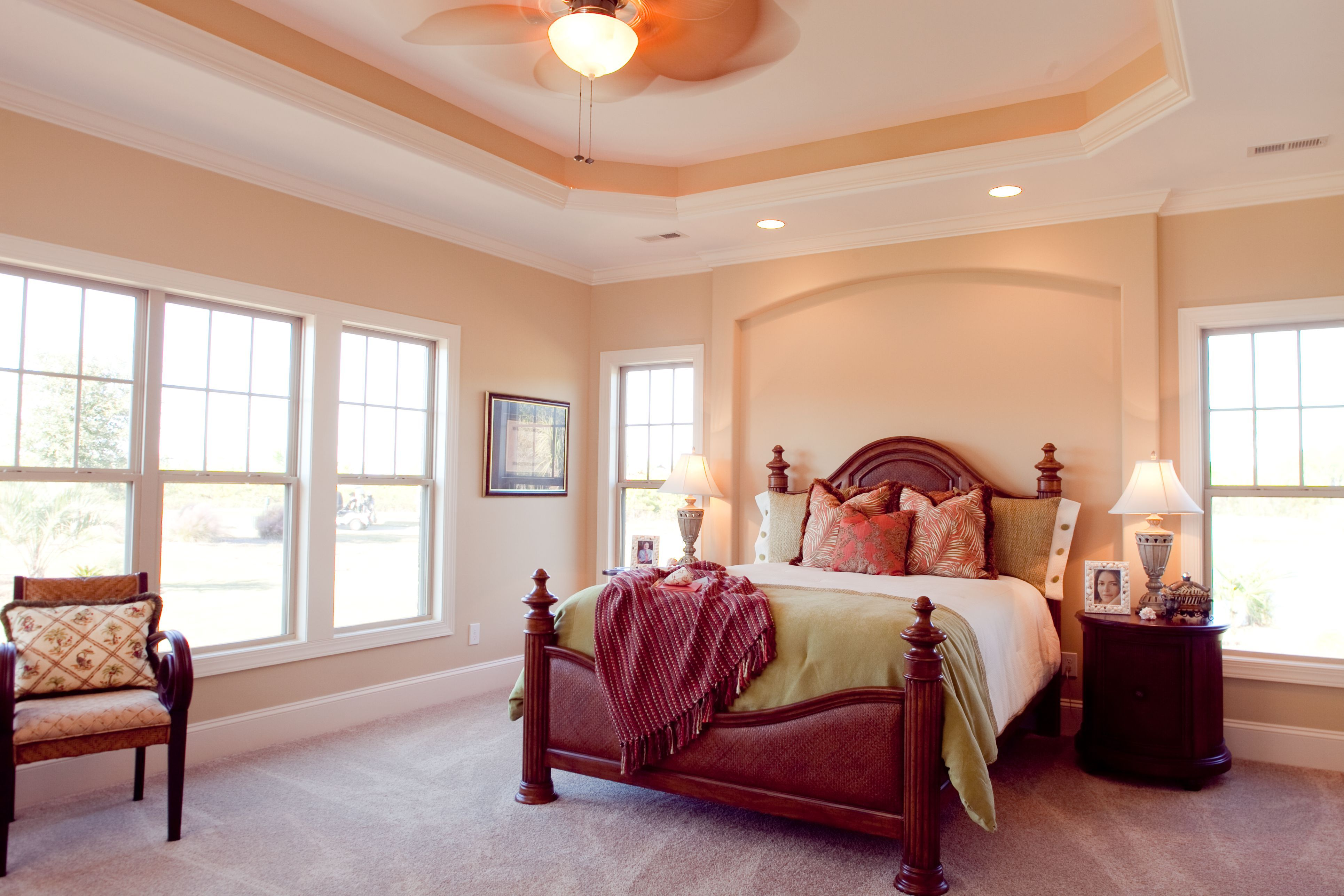 Tray ceiling, recessed lighting, windows everywhere...what