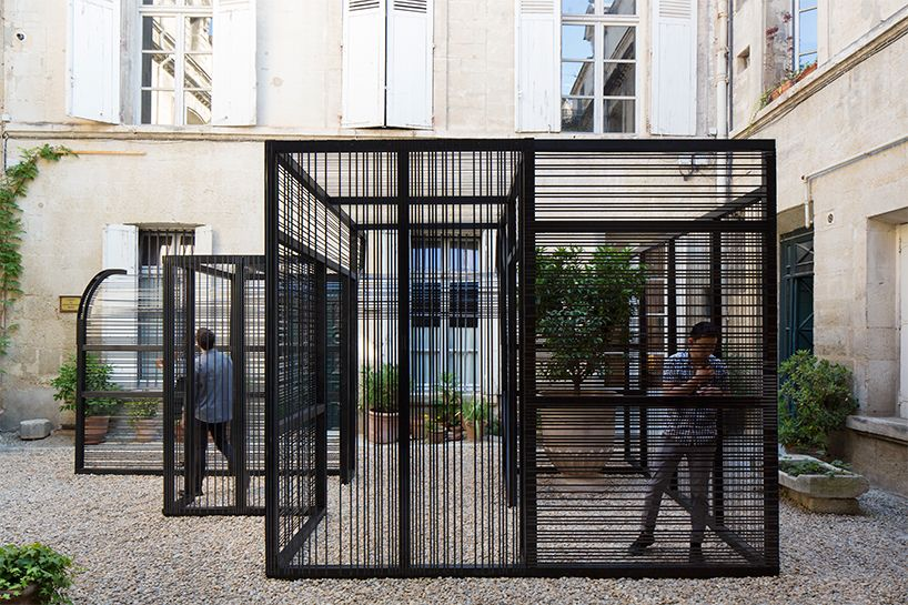 syracuse university team wraps 'trans(inter)ference' with VHS tape is part of architecture - for the lively architecture festival, a team from syracuse university have realized 'trans(inter)ference' within the courtyard of the hôtel audessan