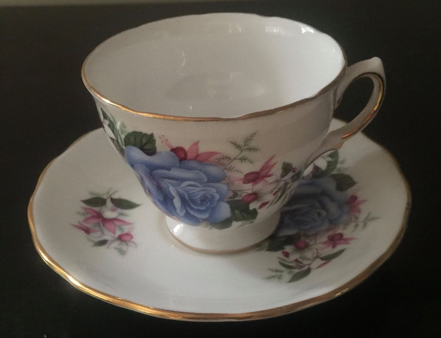 Royal vale bone china cup and saucer set made in england for How are blue roses made