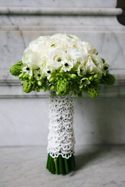 Bridal Bouquet Made Of White Ranunculas Collared By Green Arabicum And Finished In An Eyelet
