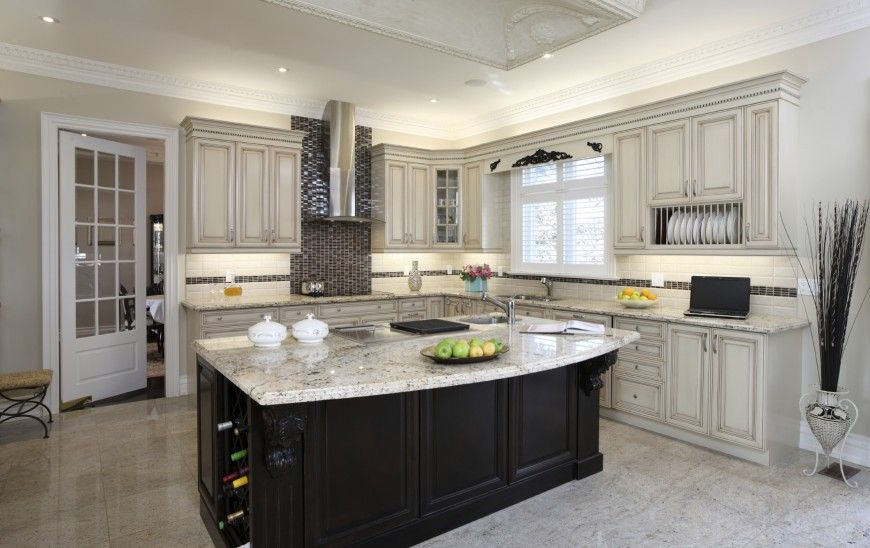 Merveilleux Light Toned Kitchen Features Immense Black Island With Built In Wine Rack  And Marble Countertop