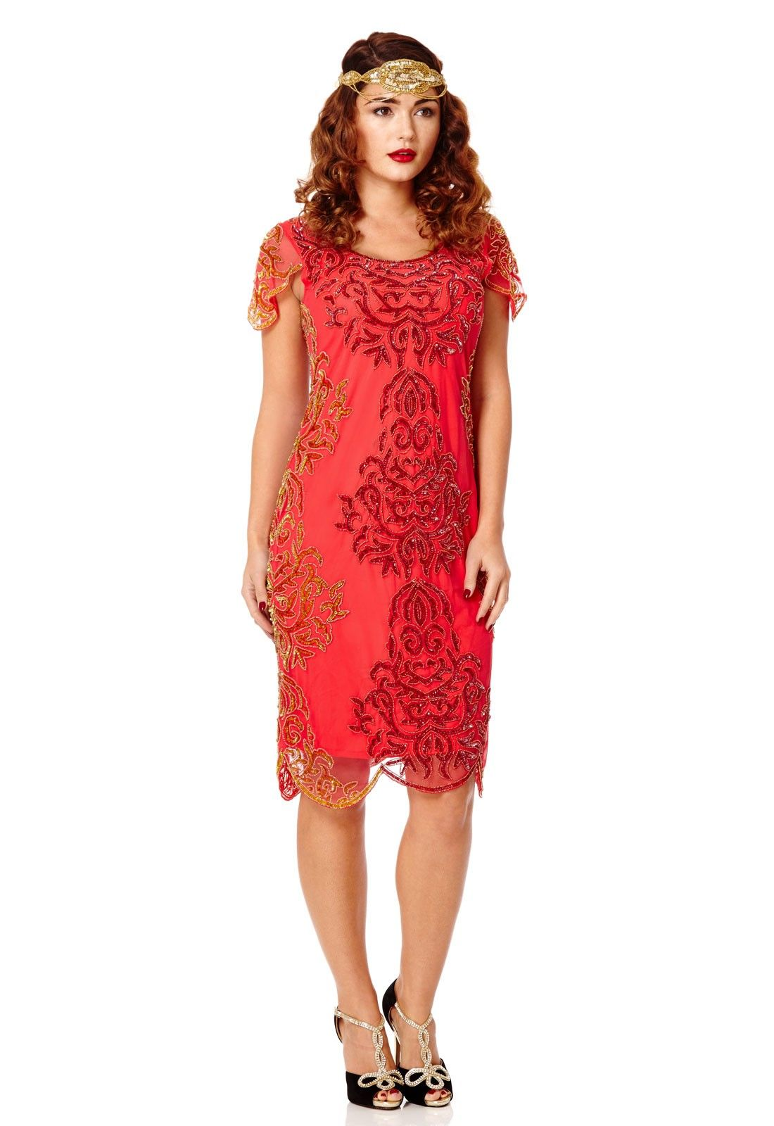 2426572f3ccb98 This stunning red flapper dress with intricate gold bead work and a  scalloped hem captures Daisy