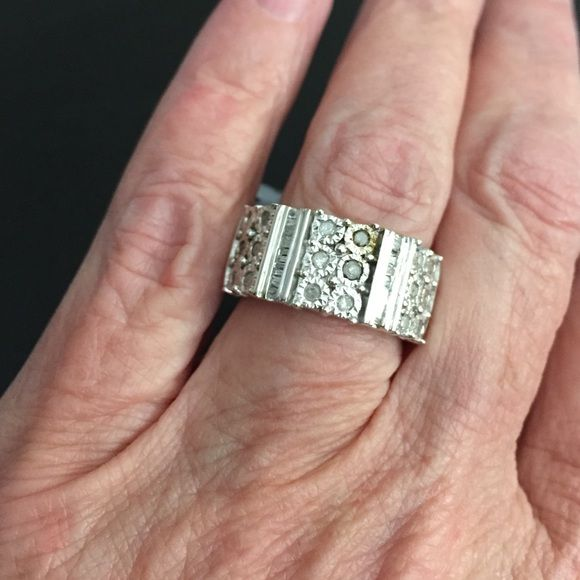 Diamond band ring Sterling Silver 1/2 CTTW diamond ring set in Sterling silver. The setting is called Illusion and is designed to give you a big look. Sz 7 new with tag. Retail 439.99 Jewelry Rings