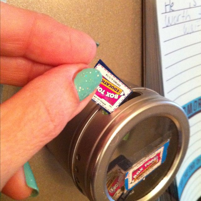 Magnetic spice jar for Box Top saver. The big slot is perfect for the box tops, convenient right on fridge. Love this idea- im sooooo doing this!