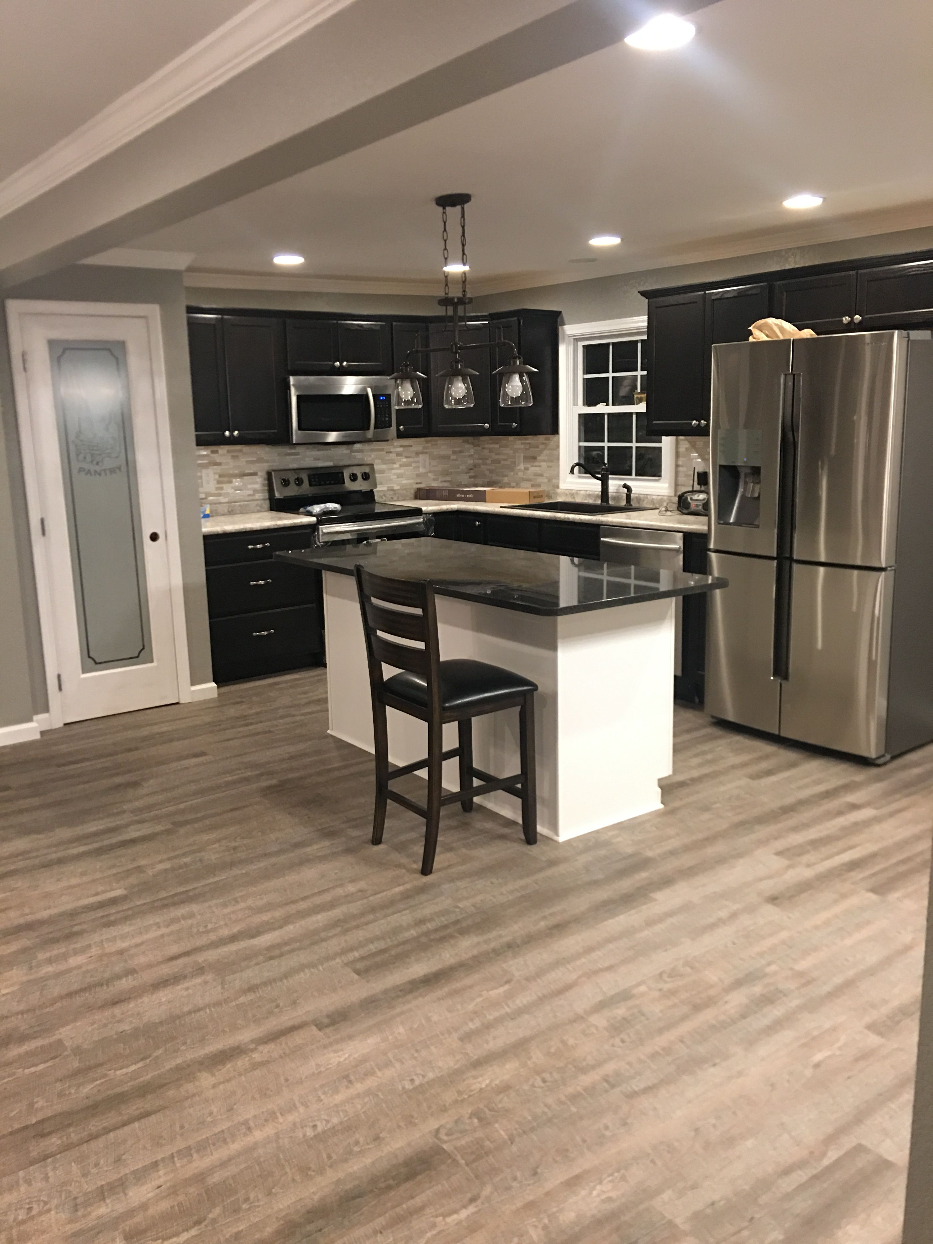 farmhouse kitchen with expresso cabinets and a white island with black pearl granite cou on farmhouse kitchen granite countertops id=50407