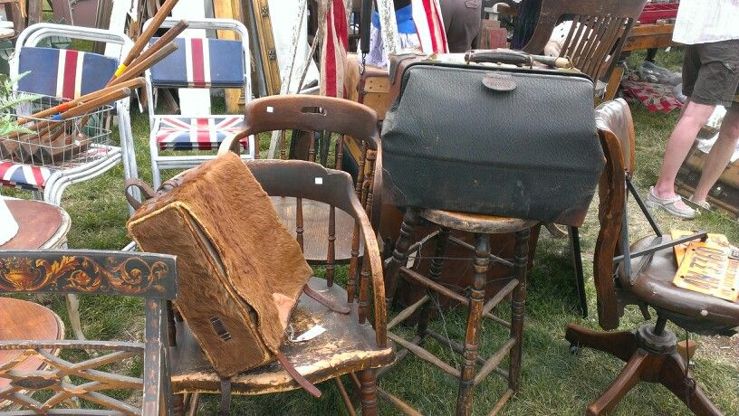 A herd of antique chairs. Photo taken by OldHouseChic.