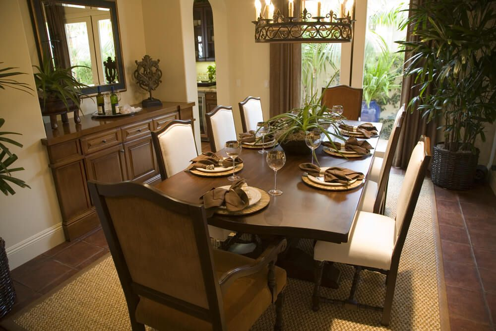 Superieur Designated Dining Room With Arched Doorway To The Kitchen. Room Floor Is  Brown Tile With Beige Floor Mat Under The Eight Person Dining Room Table.