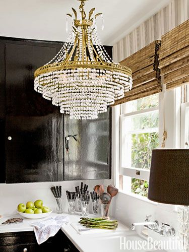 A 100 year old farmhouse goes modern high gloss kitchen cabinets a crystal chandelier and high gloss kitchen cabinets painted farrow balls pitch black aloadofball Images