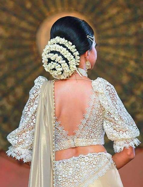 What A Beautiful Large Low Bun With Real Flower Gajra Care However Should Be Taken Indian Wedding Hairstyles Bridal Hairstyle Indian Wedding Bridal Hair Buns