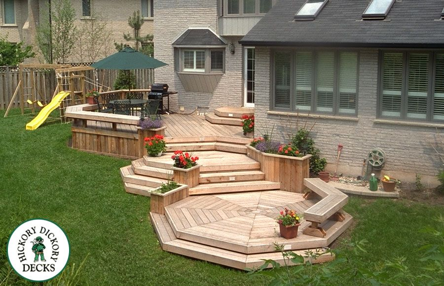 This multi level deck follows nicely the slope in the for Multi level patio designs