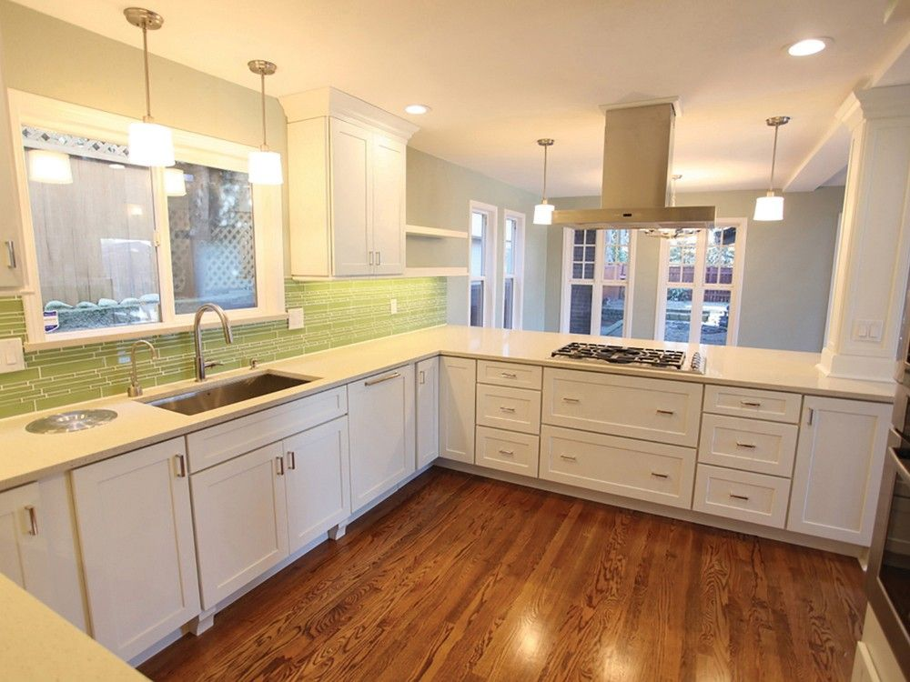 Remodeled seattle kitchen after opening wall has white for Long kitchen wall units