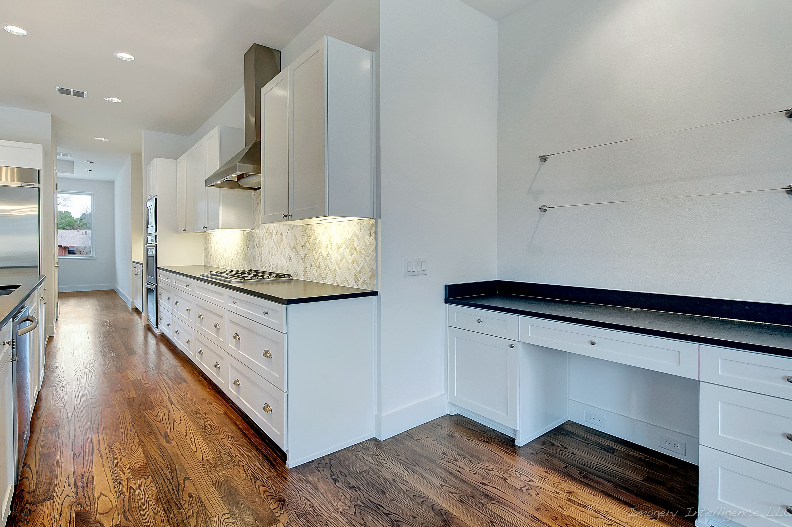 Modern kitchen with granite countertops, painted cabinet and ...