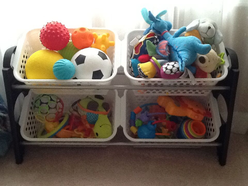 Organize baby toys using a shoe rack and 4 plastic bins ...