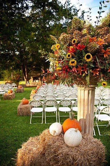 Go big or go home with these larger than life ceremony pieces. Paired with the simplicity of bales of hay and pumpkins makes a whimsical fall fairytale come to life!