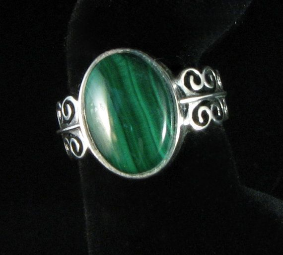 Malachite and Sterling Silver ring with beautiful detail around the band.