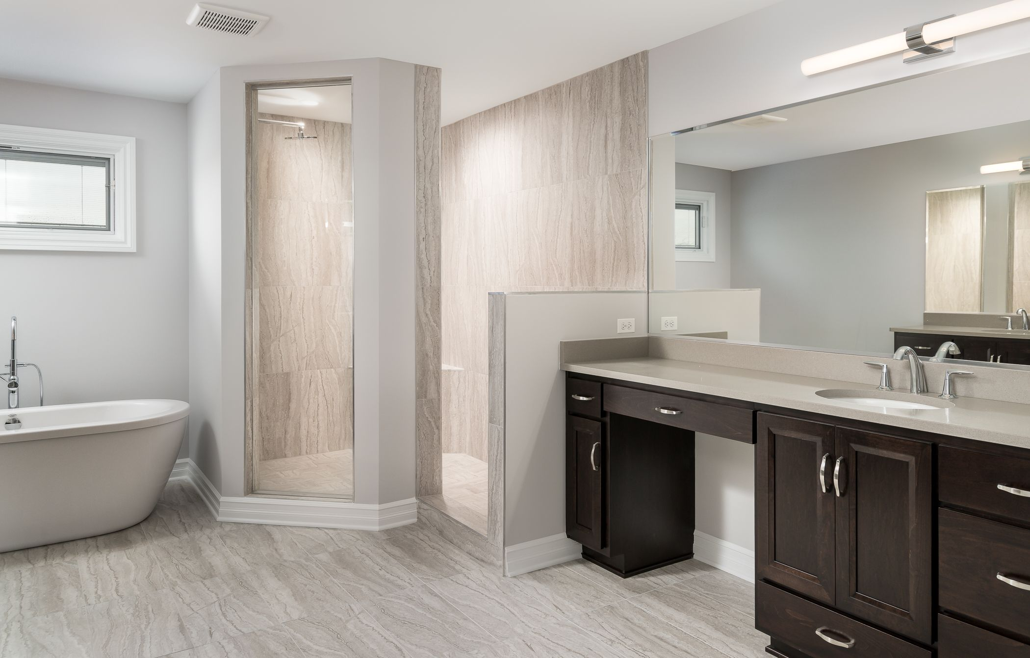 Master Bathroom With A Walk In Shower With Glass Panel And