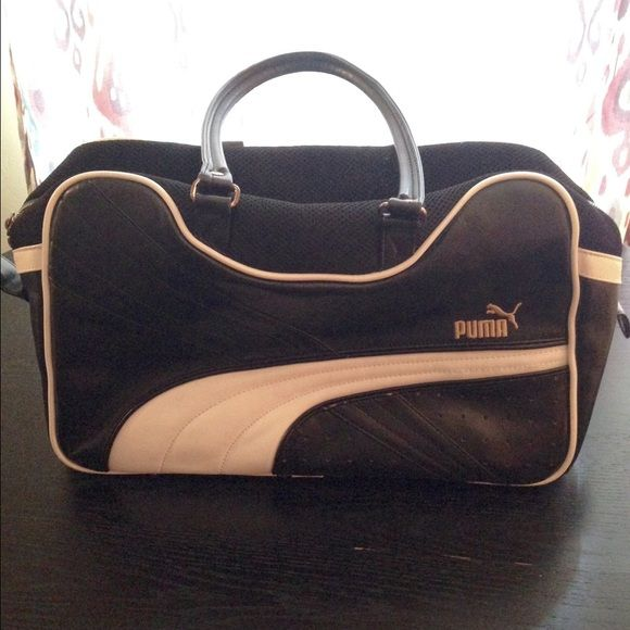 "Puma Duffle Bag Old school feel black/white duffle bag is made out of vinyl and cotton. The exterior of the bag has some peeling on the front piping as well as light scratch marks. The has one 2"" scratch mark. The bottom gas light scratch marks and a circular shape area were the vinyl has peeled off. Please see additional photos in my closet for the pictures. The inside is clean. Overall used but good condition. H 10"". W16"", D 6"" Puma Bags Totes"