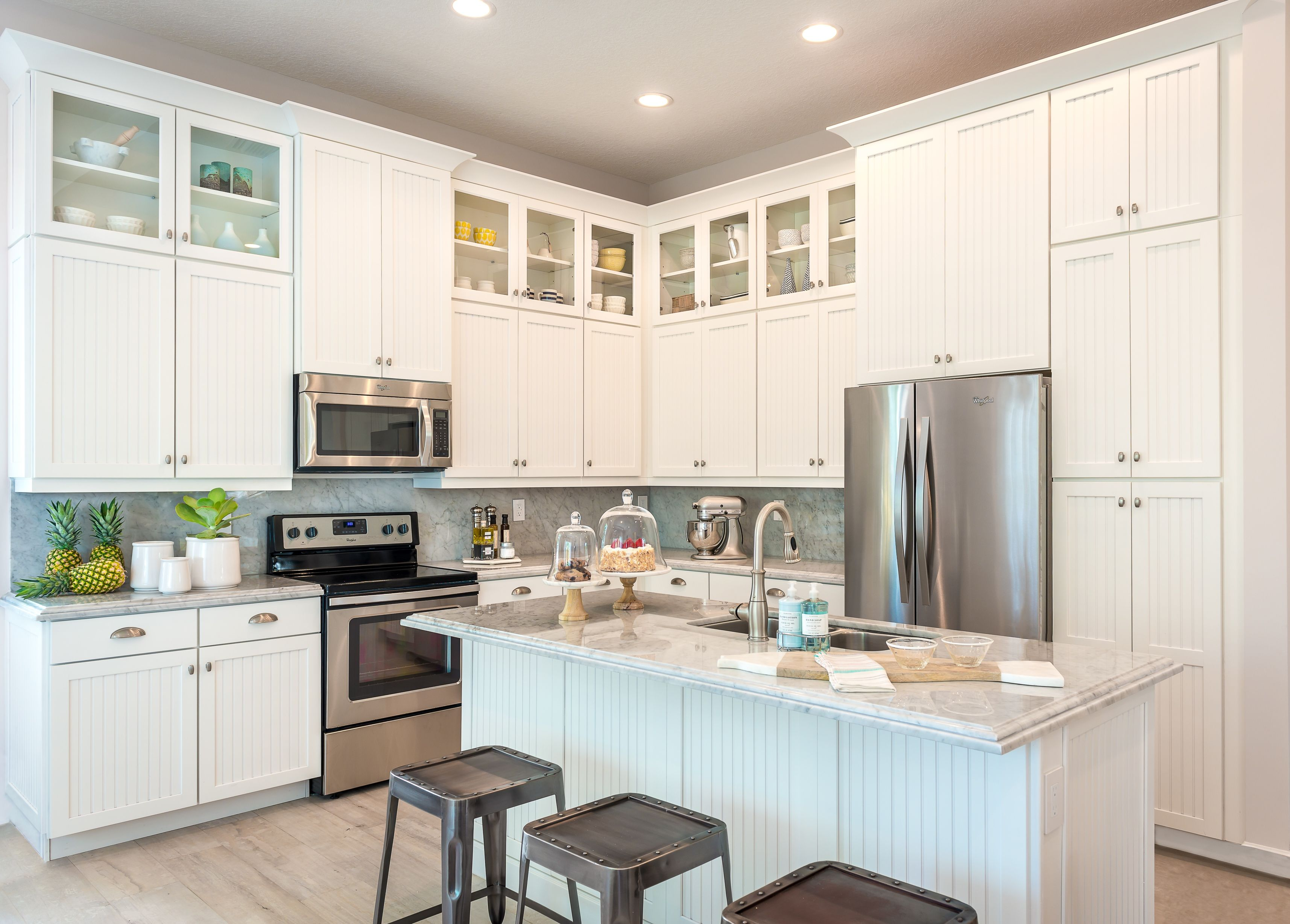 The interior design of our Brio 10 Island Colonial home - bright ...