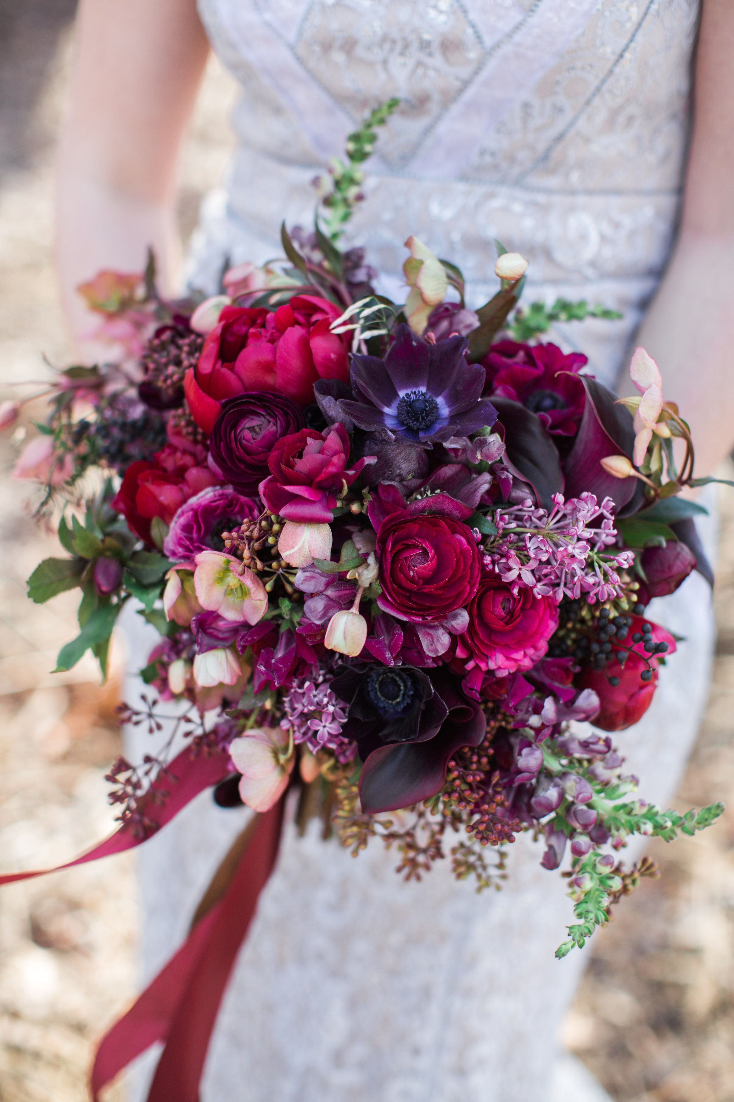 Jewel Tones Bouquet Textured With Ranunculus Anemone Lilac