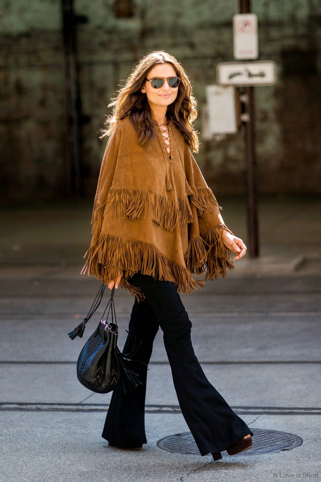 584fce55d Talitha fringed suede poncho, a Wendy Nichol bag and vintage Balmain  flares.Rare Vintage