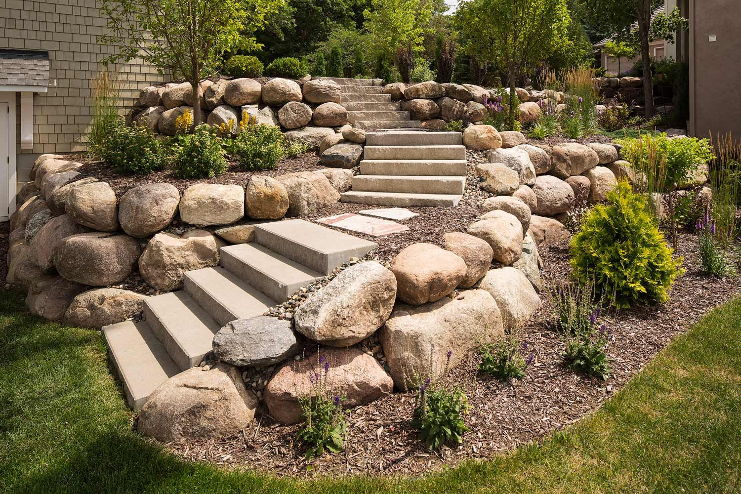 Stone Brick And Concrete Landscaping Steps Stairs Southview Design Minneapolis In 2020 Landscaping With Boulders Small Natural Garden Ideas Boulder Retaining Wall