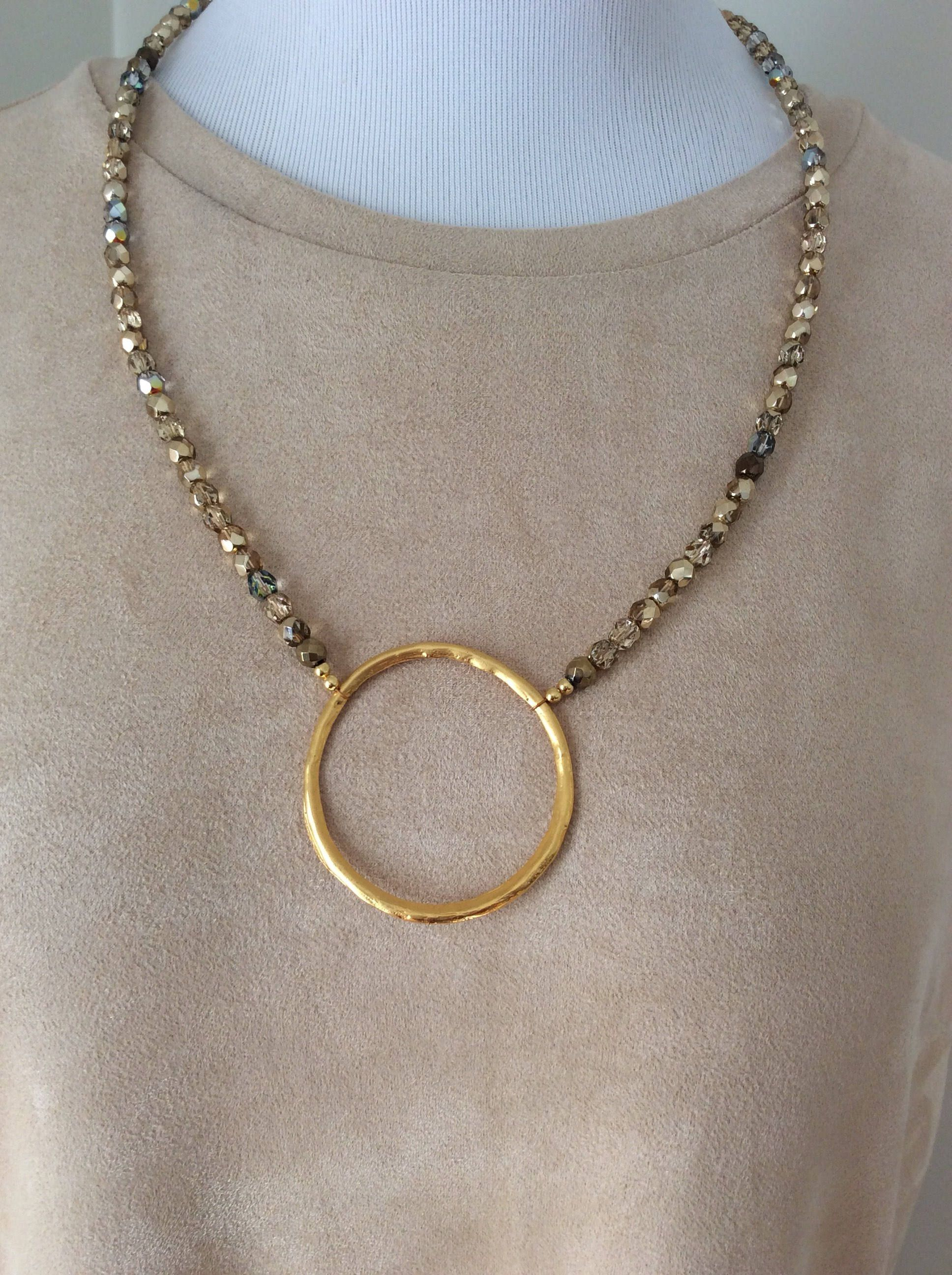 Fun gold necklace love the gold circle this one is