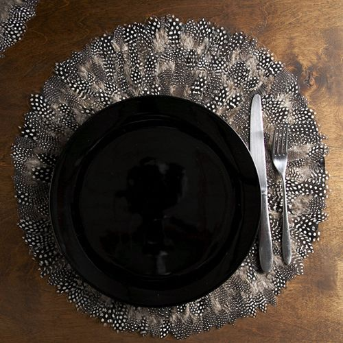 Feather placemats. These match my dishes. Need.