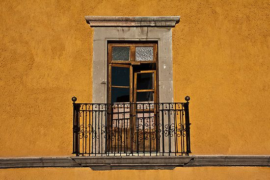 Love this window and the color of the building.