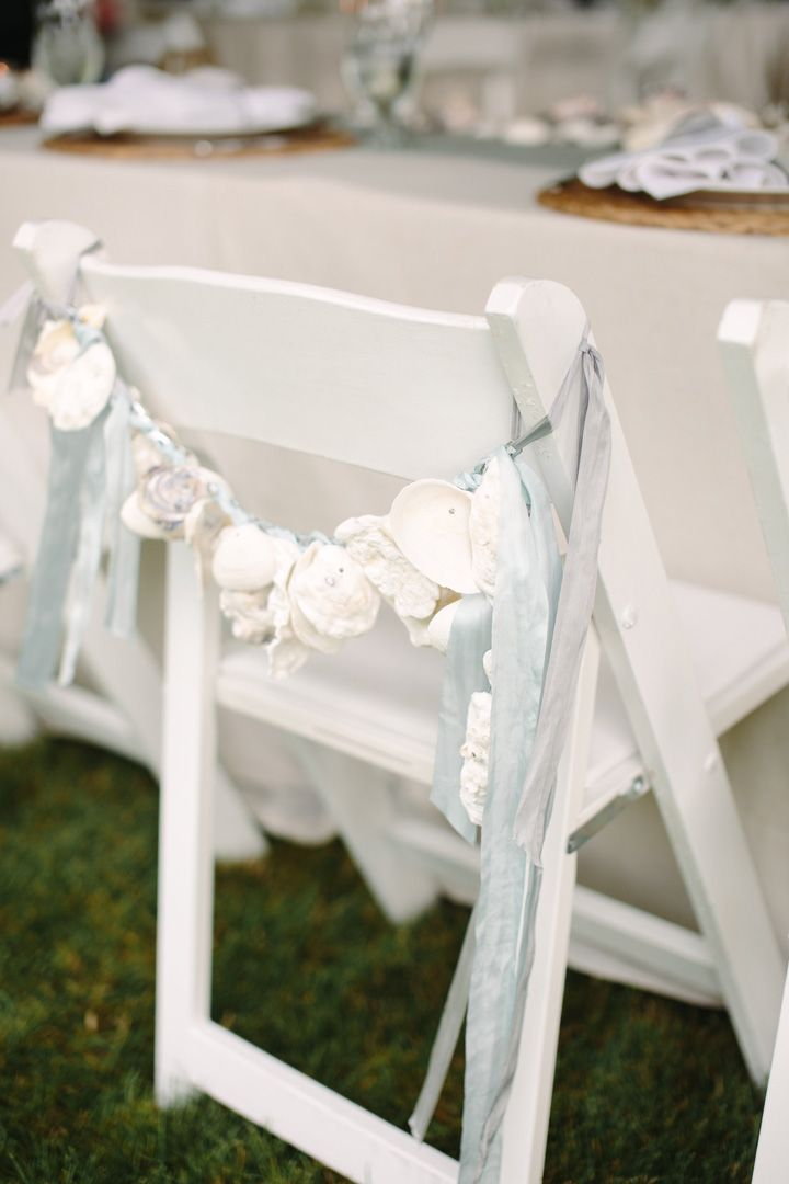 Shells decorated wedding chairs | fabmood.com #weddingdecor #beachwedding
