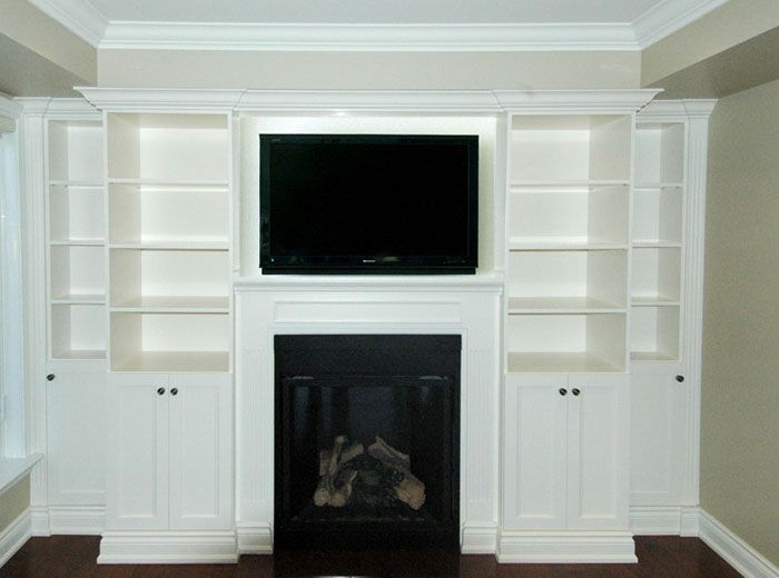 Custom wall unit with stoning around fireplace | Entertainment and ...