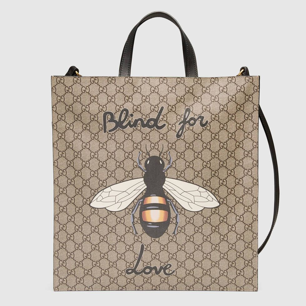 Shop the Bee print soft GG Supreme tote by Gucci. A slim tote with ... e046a0307ae35