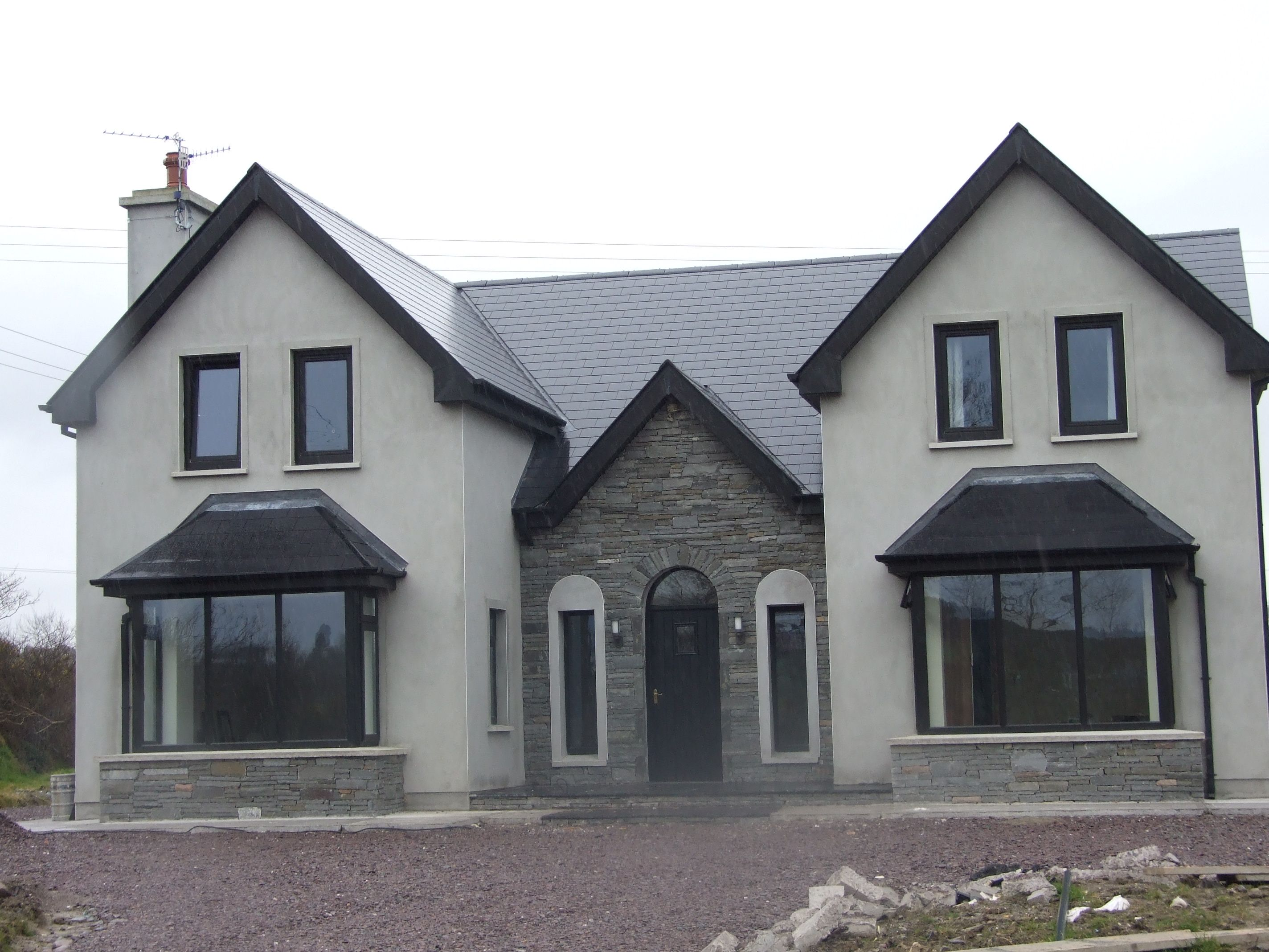 Almost finished new storey and a half residence in kerry for Georgian house plans ireland
