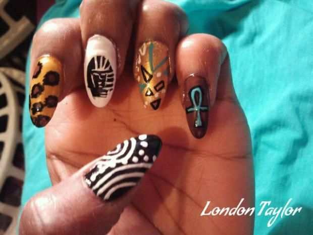 Egyptian style nail art with pharaoh and wild African animal print. - Egyptian Style Nail Art With Pharaoh And Wild African Animal Print