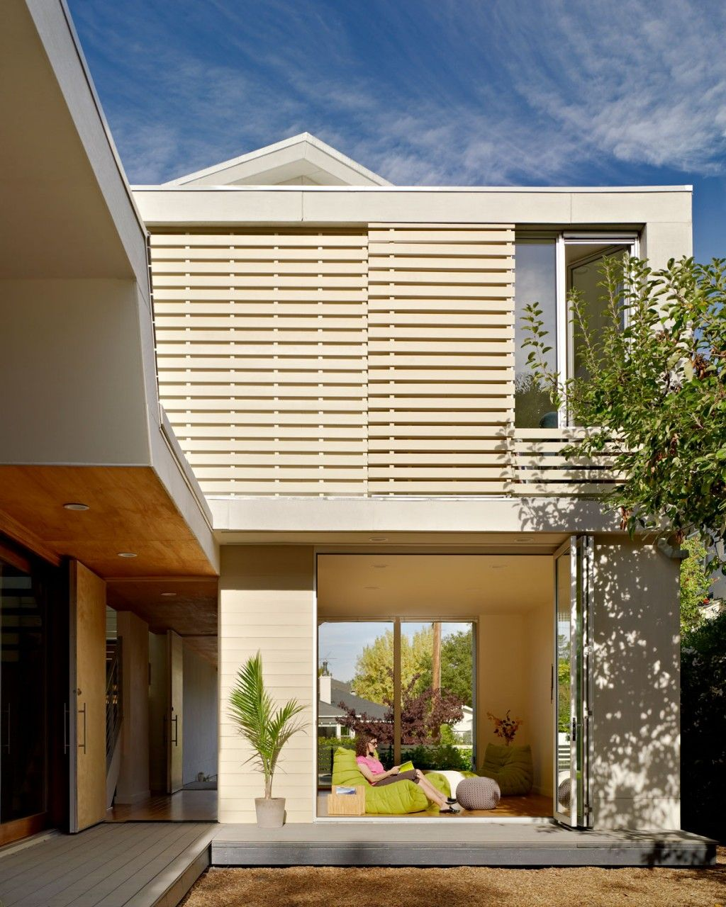 Modern Exterior Of 2 Bar House With White Wood Rain Screen Panels And White  Slatted