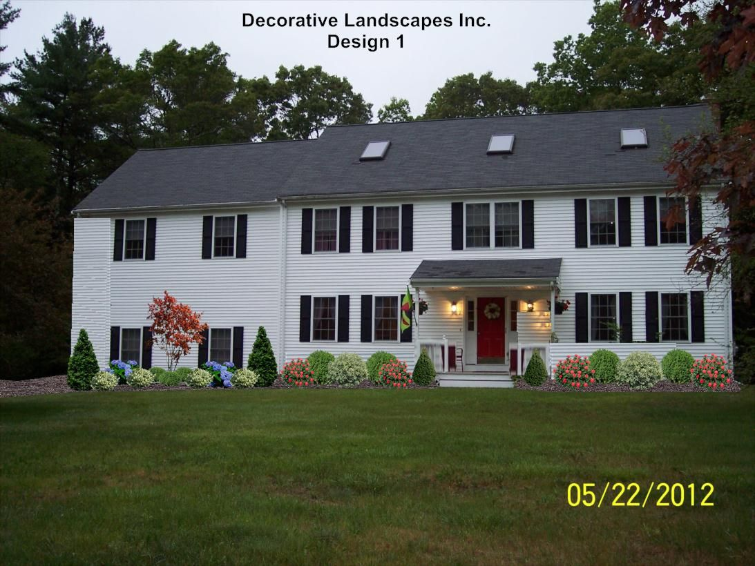 Frontyard colonial home with japanese maple tree taunton for Colonial landscape design