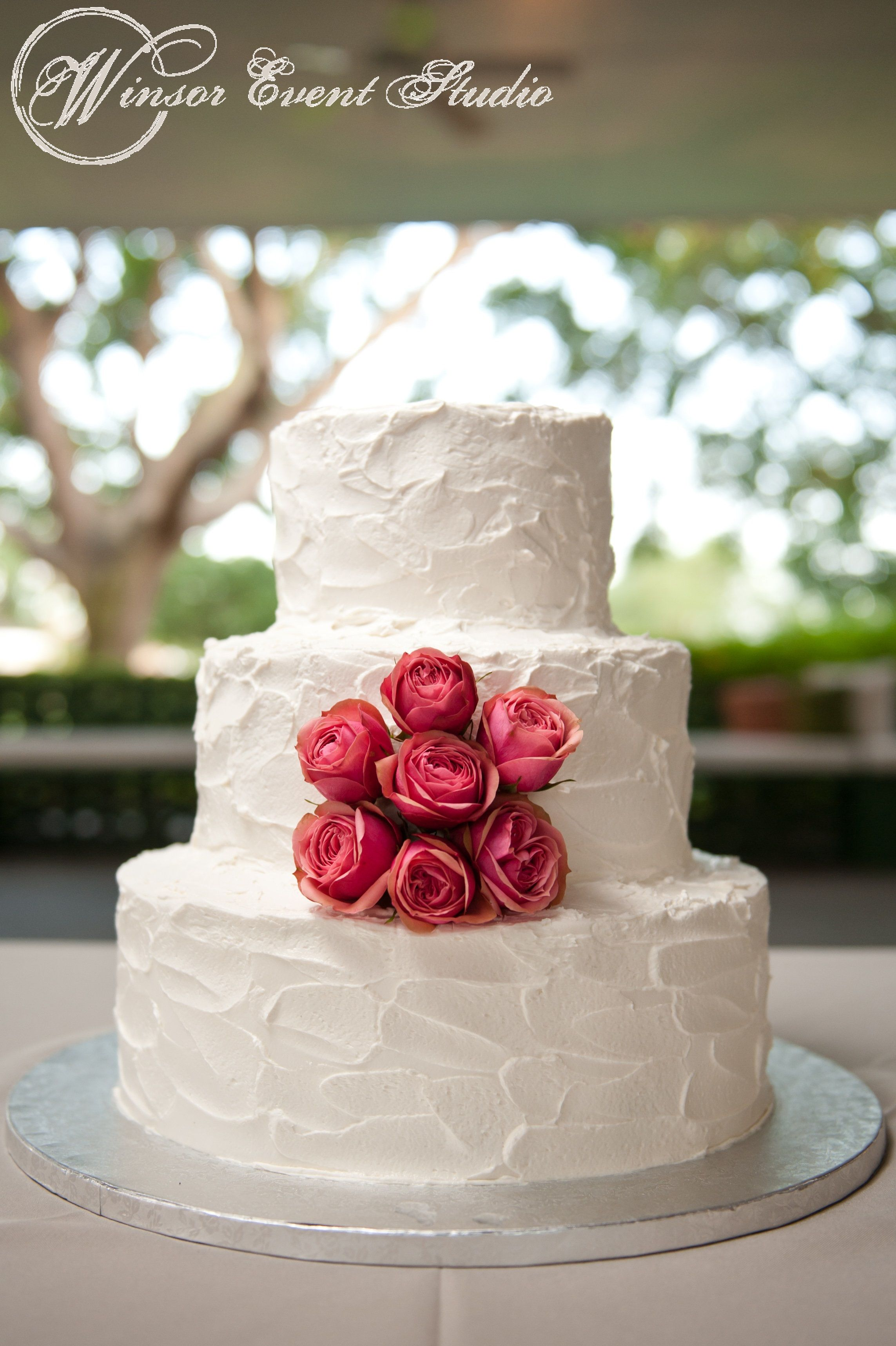 Simple buttercream wedding cake with coral spray roses  Wedding Cakes  Wedding Wedding cake