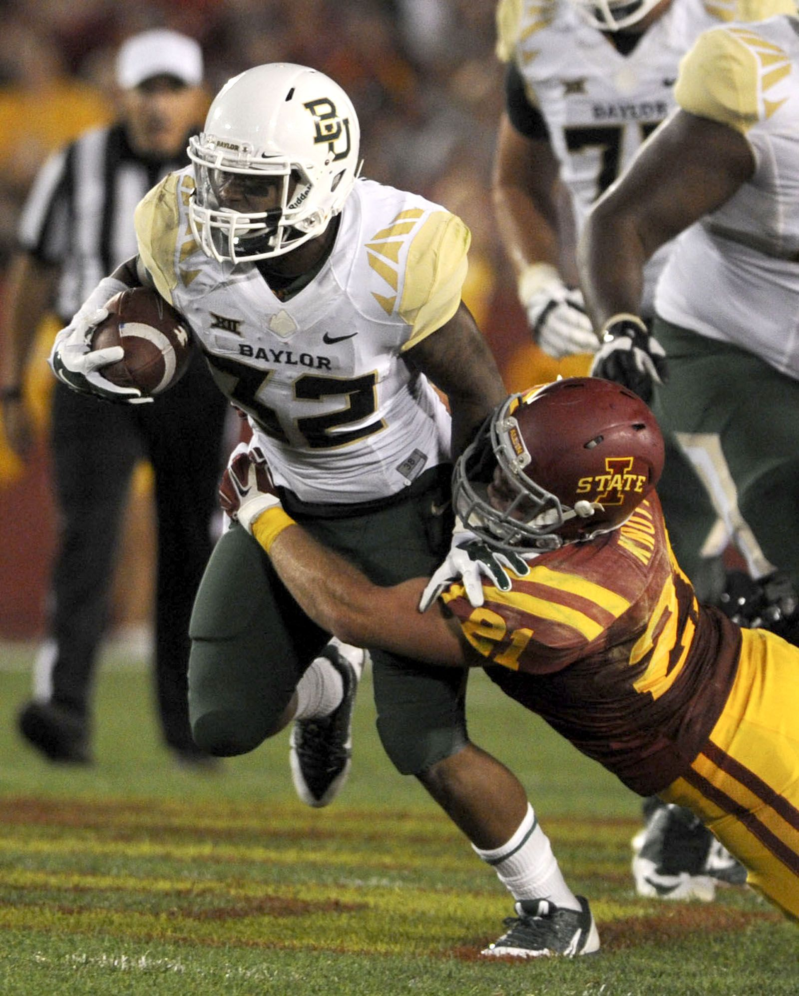 Baylor Running Back Shock Linwood Tries To Break The Tackle Of
